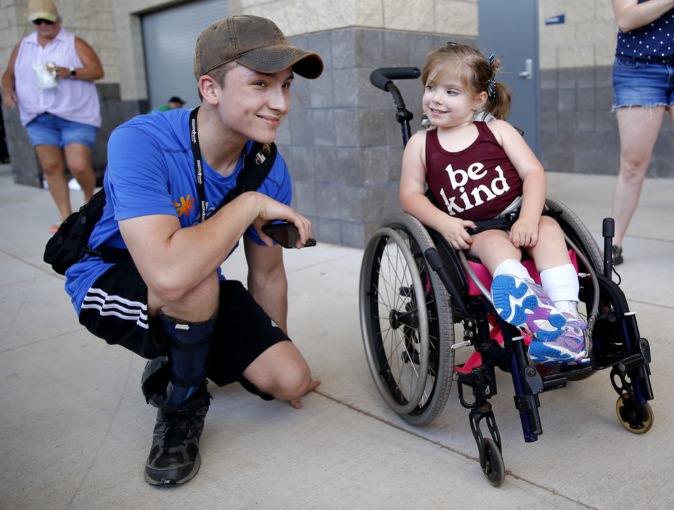 Photo -  Poppy Cox, right, talks with Trevor Coburn during the during the Endeavor Games on Saturday at Edmond North High School. [Sarah Phipps/The Oklahoman]