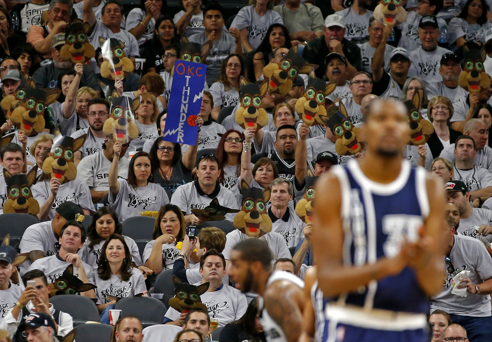 Photo - San Antonio fans cheer during Game 1 of the second-round series between the Oklahoma City Thunder and the San Antonio Spurs in the NBA playoffs at the AT&T Center in San Antonio, Saturday, April 30, 2016. San Antonio won 124-92. Photo by Bryan Terry, The Oklahoman
