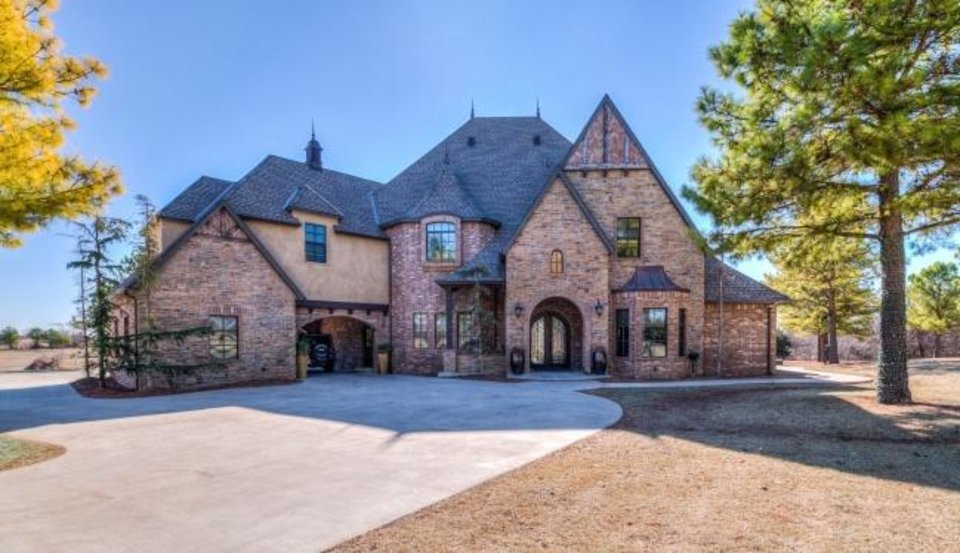 Photo -  Jennifer Gilchrest, of Keller Williams Realty Green Meadow, has this 5,309-square-foot, four-bedroom, 3  -bath home at 404 Jeffries Drive in Tuttle listed for $1,299,998. [PHOTO PROVIDED]