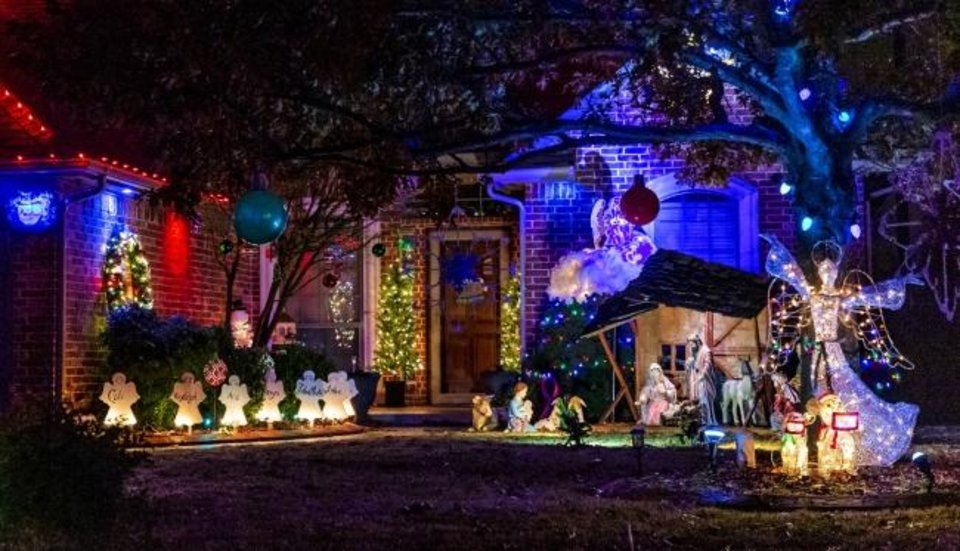 Photo -  Christmas decorations at 10608 SW 21 in Yukon. [CHRIS LANDSBERGER/THE OKLAHOMAN]