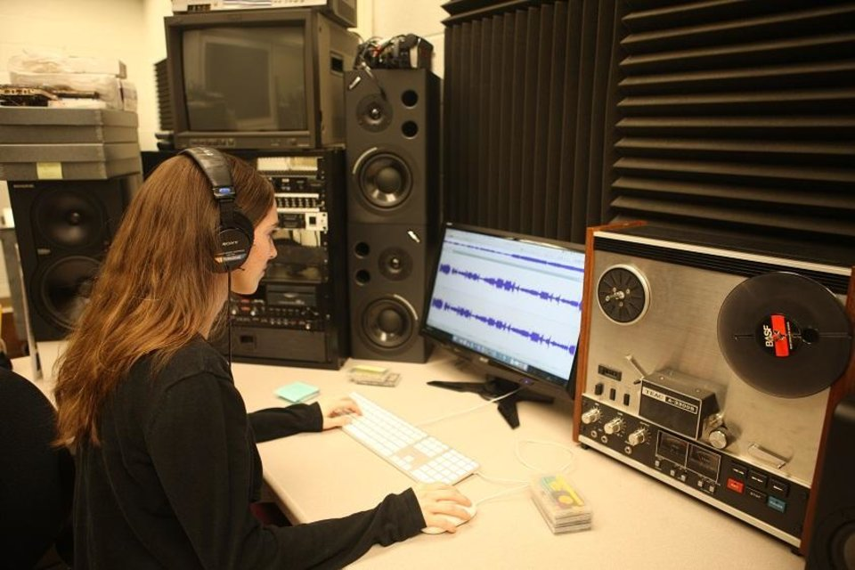 Photo - Dr. Raina Heaton, curator of Native American languages at the University of Oklahoma's Sam Noble Museum, works to process an audio recording in the museum's collection. A nearly $40,000 National Endowment for the Humanities grant was awarded to OU researchers to work in consultation with Native American communities to develop protocols for preserving and digitizing audio and audiovisual recordings of Native music currently held in community. [Photo provided]