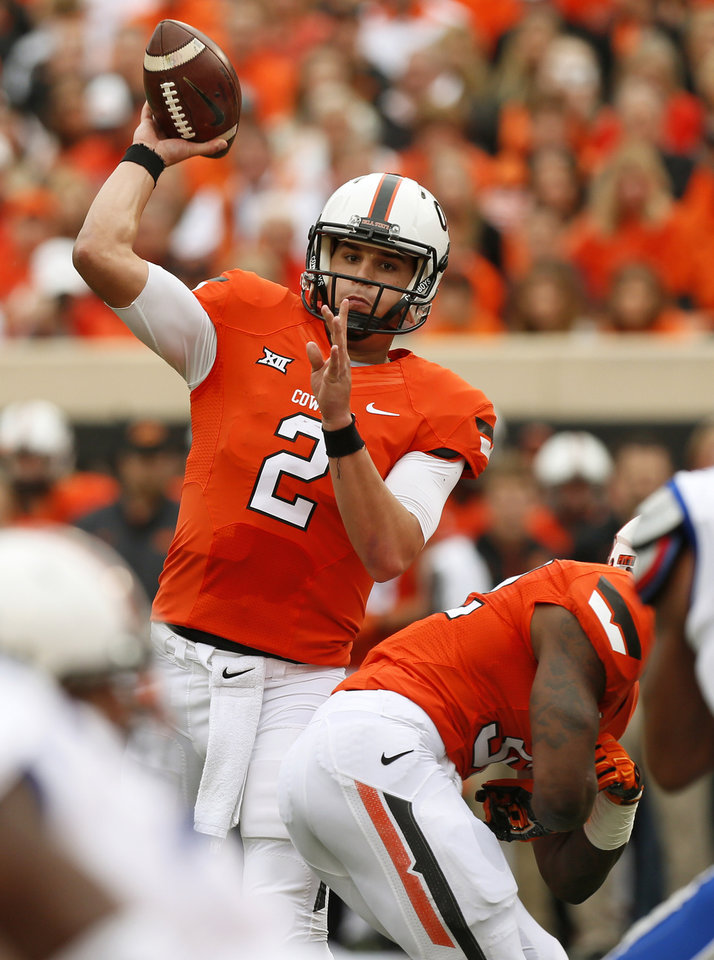 Photo - Oklahoma State's Mason Rudolph (2) passes during a college football game between the Oklahoma State University Cowboys (OSU) and the Kansas Jayhawks (KU) in Stillwater, Okla., Saturday, Oct. 24, 2015. Photo by Nate Billings, The Oklahoman