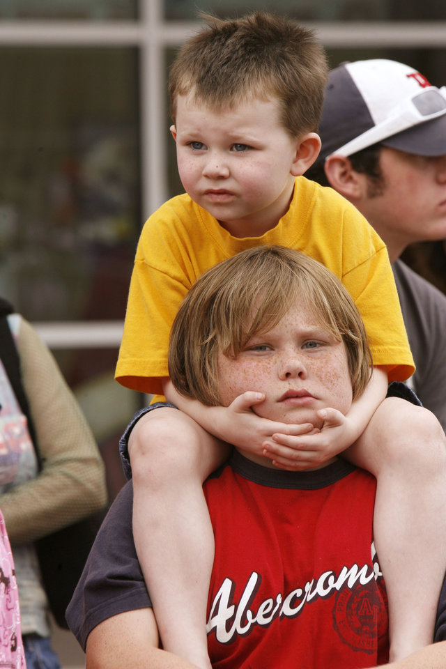 Photo - Five year old Tylyn Ramos watches from the shoulders of his brother Dyllan, 13, during the Oklahoma Centennial Parade in downtown Oklahoma City, Okla., Sunday, October 14, 2007. Photo by Paul Hellstern / The Oklahoman.