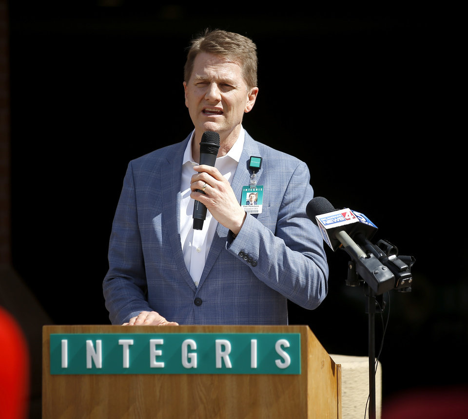 Photo - Integris President and CEO Tim Pehrson speaks during a COVID-19 press conference in front of Integris Baptist Medical Center in Oklahoma City, Wednesday, March 18, 2020. [Bryan Terry/The Oklahoman]
