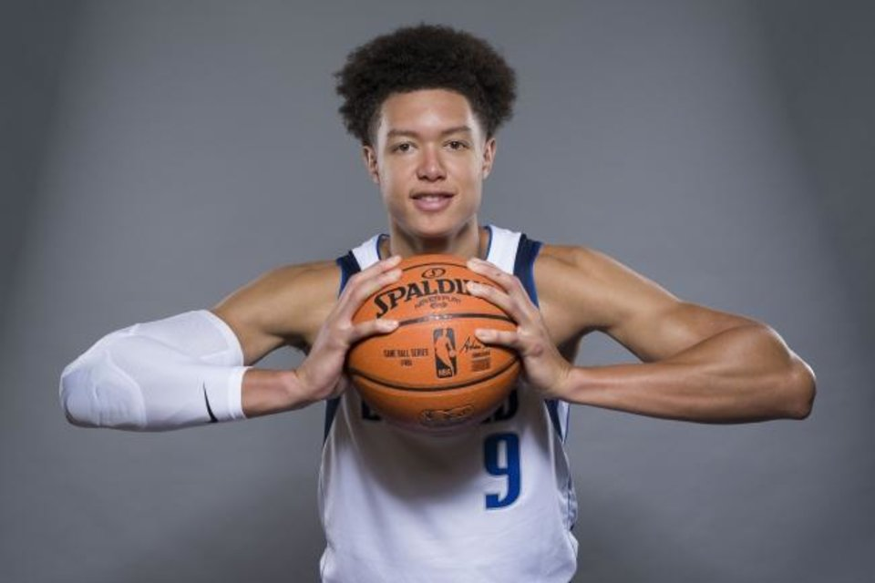 Photo -  Dallas Mavericks forward Isaiah Roby poses during NBA  team's media day in Dallas. [AP Photo/Jim Cowsert]