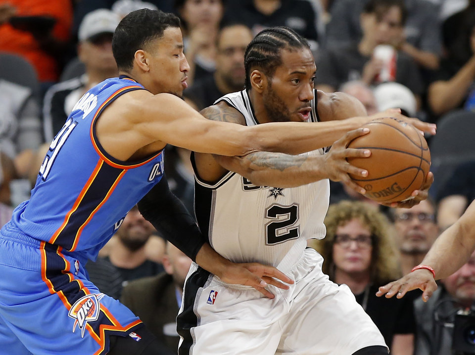 Photo - Oklahoma City's Andre Roberson (21) defends San Antonio's Kawhi Leonard (2) during Game 5 of the second-round series between the Oklahoma City Thunder and the San Antonio Spurs in the NBA playoffs at the AT&T Center in San Antonio, Tuesday, May 10, 2016. Oklahoma City won 95-91. Photo by Bryan Terry, The Oklahoman