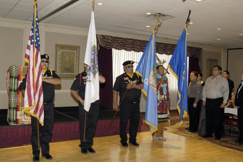 Photo -  An honor guard representing the Seminole Nation of Oklahoma presents the colors at a Native American Heritage Month event. The events are sponsored by the Tinker Inter-Tribal Council, which is an active organization that promotes diversity and inclusion on the Air Force base and in the community.