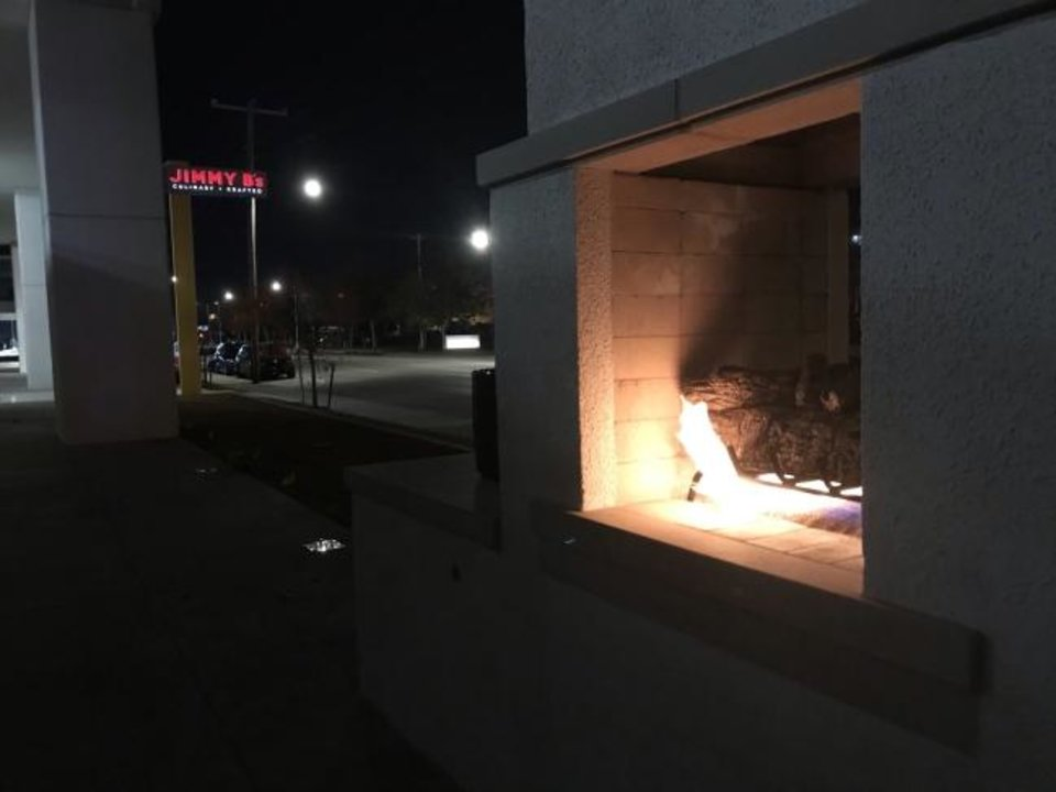 Photo -  The fireplace outside Jimmy B's Culinary and Hand-Krafted in Automobile Alley. [Dave Cathey/The Oklahoman]