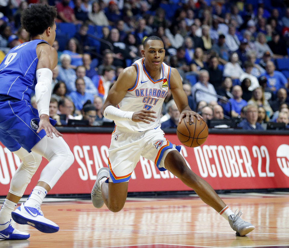 Photo - Oklahoma City's Darius Bazley (7) looks to get by Dallas's Isaiah Roby during the preseason NBA game between the Oklahoma City Thunder and the Dallas Mavericks at the BOK Center in Tulsa, Okla. , Tuesday, Oct. 8, 2019. [Sarah Phipps/The Oklahoman]