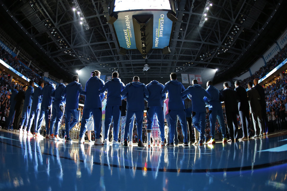 Photo - The Oklahoma City Thunder bow their heads during a pray before an NBA basketball game between the Oklahoma City Thunder and the Sacramento Kings at Chesapeake Energy Arena in Oklahoma City, Sunday, Oct. 21, 2018. Photo by Bryan Terry, The Oklahoman