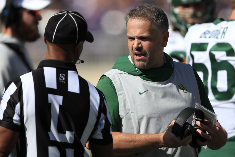 Photo - Baylor head coach Matt Rhule, right, talks with line judge Quentin Givens, left, during the first half of an NCAA college football game against Kansas State in Manhattan, Kan., Saturday, Oct. 5, 2019. (AP Photo/Orlin Wagner)