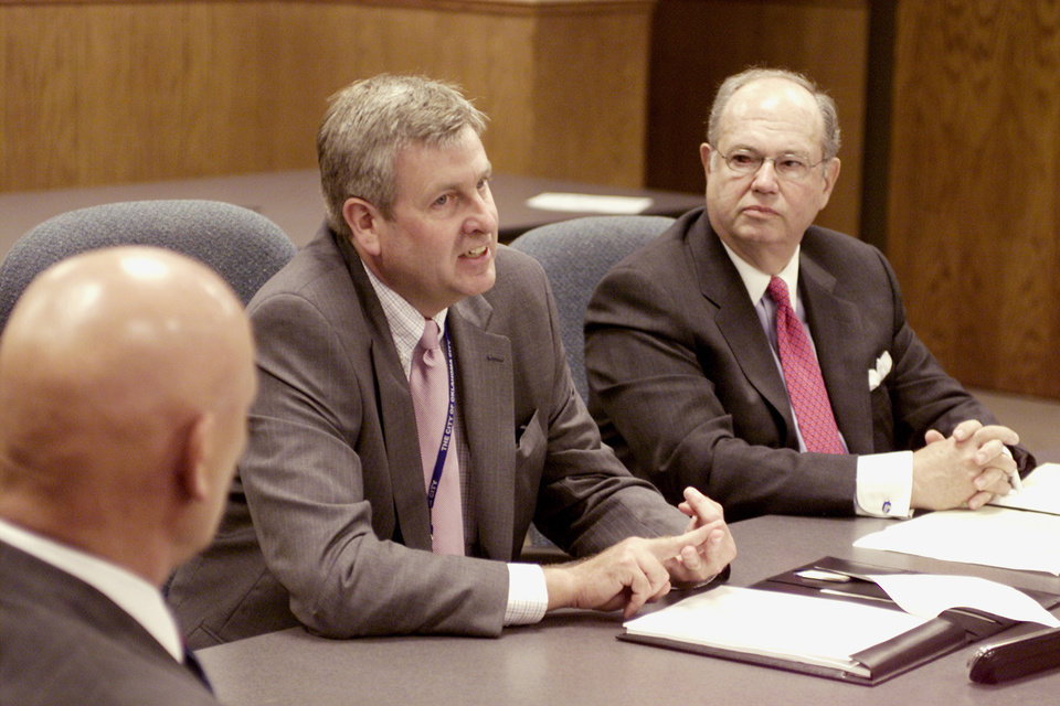 Photo -  Jim Couch, center, oversaw the reorganization of the MAPS planning and construction process before being named city manager in 2000. He convened the final MAPS Citizens Oversight Board meeting in 2004. [Oklahoman Archives Photo]