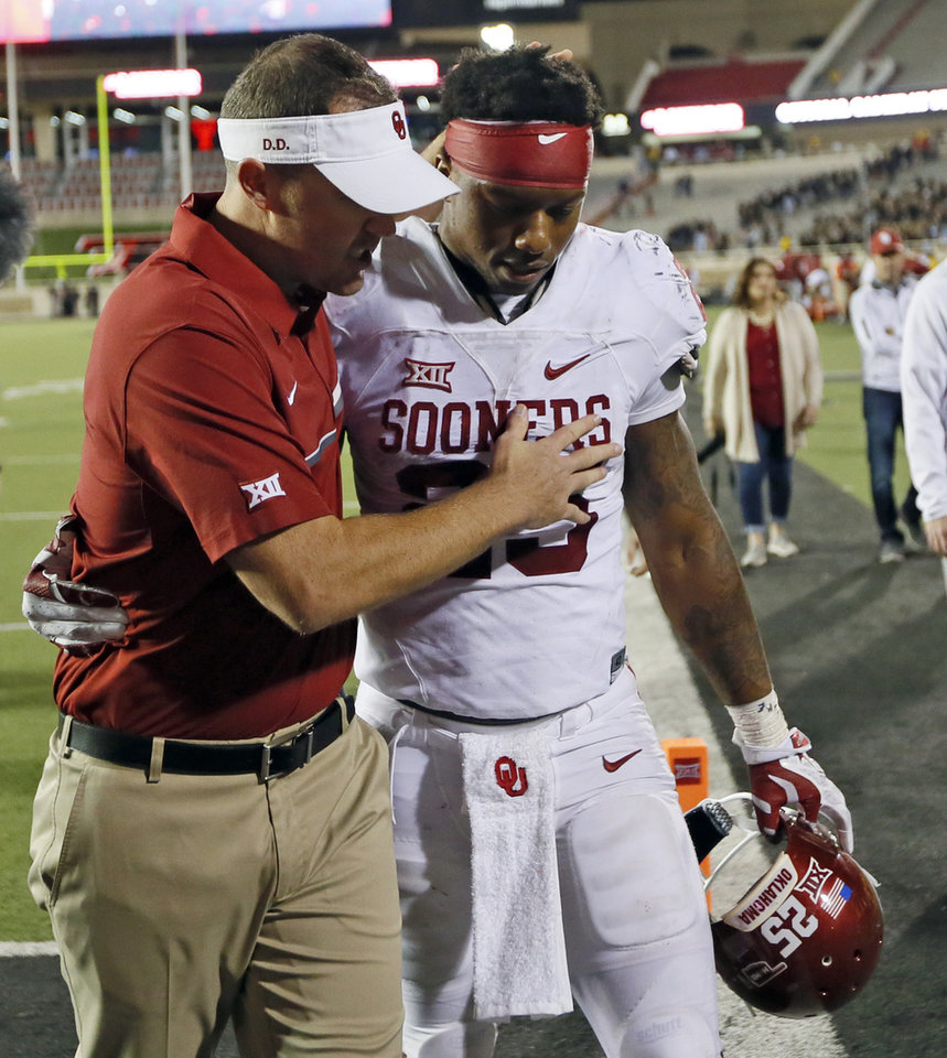 Photo - OU offensive coordinator Lincoln Riley leaves the field with Joe Mixon (25) after a college football game between the University of Oklahoma Sooners (OU) and Texas Tech Red Raiders at Jones AT&T Stadium in Lubbock, Texas, Saturday, Oct. 22, 2016. OU won 66-59. Photo by Nate Billings, The Oklahoman