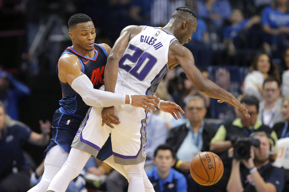Photo - Oklahoma City's Russell Westbrook (0) tries to steal the ball from Sacramento's Harry Giles (20) during an NBA basketball game between the Oklahoma City Thunder and the Sacramento Kings at Chesapeake Energy Arena in Oklahoma City, Sunday, Oct. 21, 2018. Photo by Bryan Terry, The Oklahoman