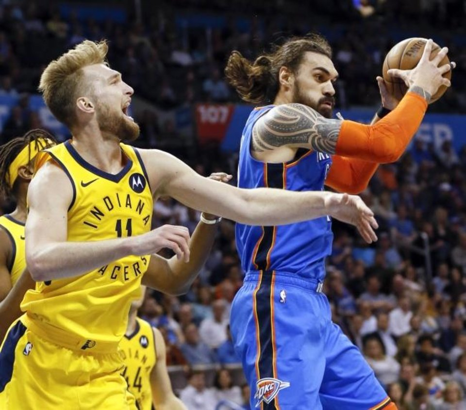 Photo -  Oklahoma City's Steven Adams, right, grabs a rebound next to Indiana's Domantas Sabonis during a March 2019 game at Chesapeake Energy Arena. [Nate Billings/The Oklahoman]