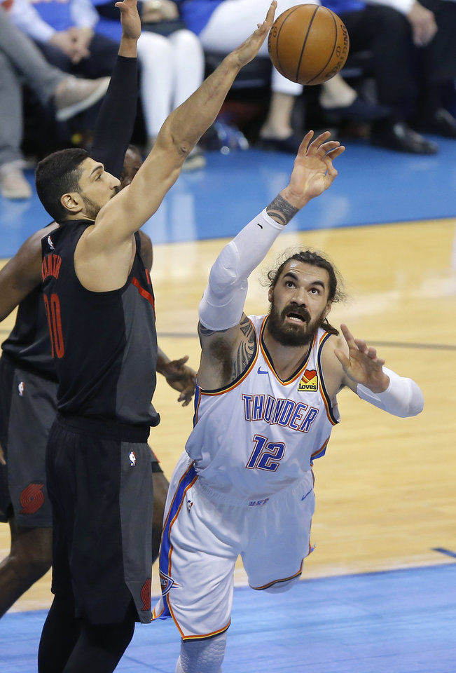 Photo - Oklahoma City's Steven Adams (12) puts up a shot beside Portland's Enes Kanter (00) during Game 4 in the first round of the NBA playoffs between the Portland Trail Blazers and the Oklahoma City Thunder at Chesapeake Energy Arena in Oklahoma City, Sunday, April 21, 2019. Photo by Bryan Terry, The Oklahoman