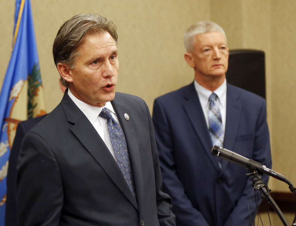Photo - Oklahoma Attorney General Mike Hunter, left, speaks as Department of Corrections Director Scott Crow stands during a press conference announcing plans for Oklahoma to resume executions by lethal injection, at the Office of the Attorney General, 313 NE 21, in Oklahoma City, Thursday, Feb. 13, 2020. [Nate Billings/The Oklahoman]