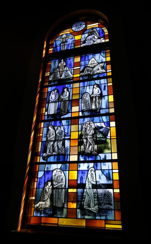 Photo -  Stained glass windows pay tribute to martyrs Rev. Stanley Rother, Miguel Pro and Edith Stein at St. Eugene Catholic Church in Oklahoma City. [Photo by Steve Sisney The Oklahoman]