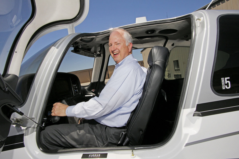 Photo -  OAA chief executive Tony Caldwell flew himself to Tulsa on Monday to call on an independent insurance agent there. Photo by Doug Hoke, The Oklahoman   DOUG HOKE -  THE OKLAHOMAN