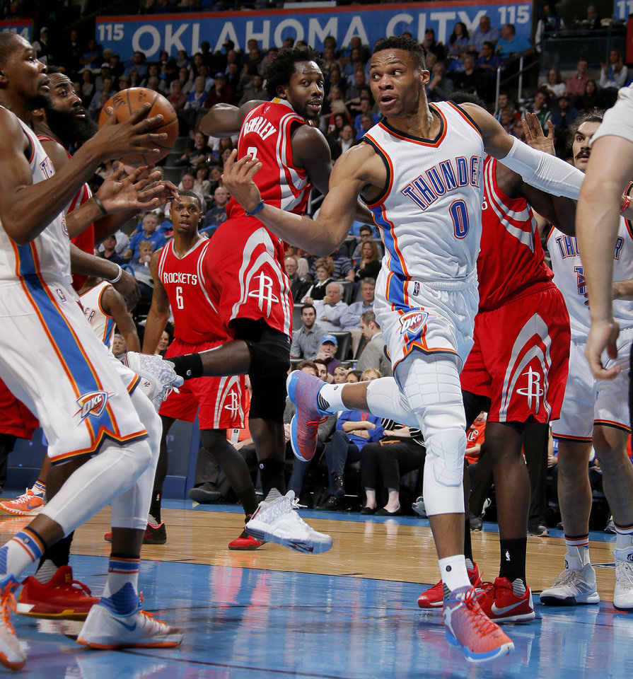 Photo - Oklahoma City's Russell Westbrook (0) passes to Kevin Durant (35) during an NBA basketball game between the Oklahoma City Thunder and the Houston Rockets at Chesapeake Energy Arena in Oklahoma City, Friday, Jan. 29, 2016. Photo by Bryan Terry, The Oklahoman