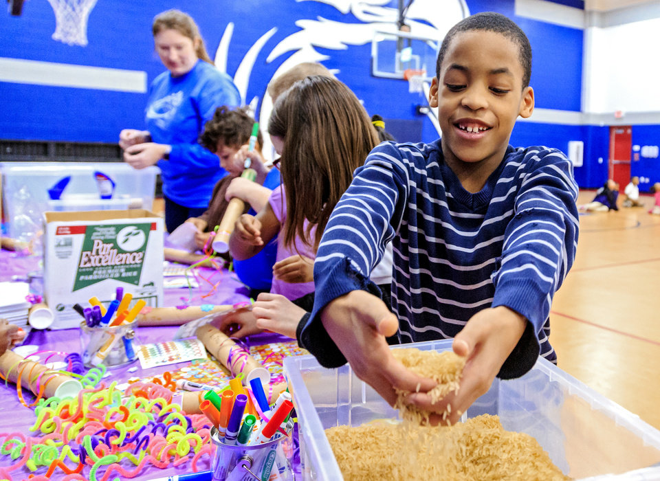 Photo - Edward Elementary second grader Jonah Long uses rice to make a rain stick during an mindfulness activity during the celebration of the classes achievements for the Wiggle Out Loud activity challenge at Edward Elementary School in Oklahoma City, Okla. on Friday, March 1, 2019. Photo by Chris Landsberger, The Oklahoman