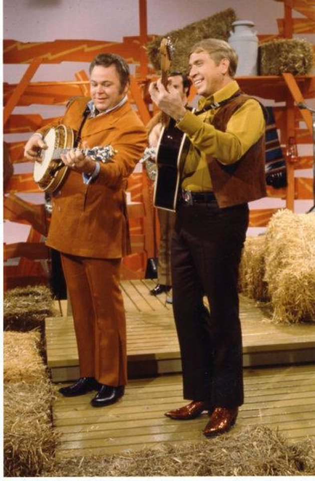 Photo - Tulsa resident Roy Clark, left, and Buck Owens co-hosted the long-running TV show