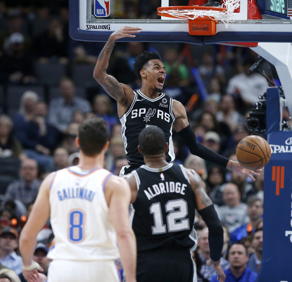 Photo - San Antonio's Dejounte Murray (5) dunks the ball during an NBA basketball game between the Oklahoma City Thunder and the San Antonio Spurs at Chesapeake Energy Arena in Oklahoma City, Tuesday, Feb. 11, 2020. [Bryan Terry/The Oklahoman]