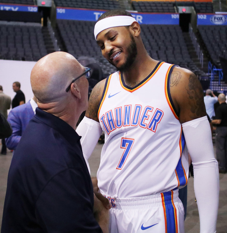 Photo - Carmelo Anthony talks with Thunder broadcaster Brian Davis during Thunder Media Day at the Chesapeake Arena in downtown Oklahoma City, Monday, September 25, 2017. Photo by Doug Hoke, The Oklahoman
