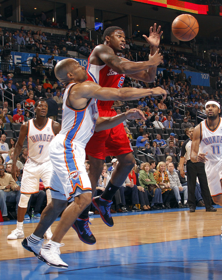 Photo - Oklahoma City's Derek Fisher (37) fouls Los Angeles Clippers guard Travis Leslie (23) during the NBA basketball game between the Oklahoma City Thunder and the Los Angeles Clippers at Chesapeake Energy Arena on Wednesday, March 21, 2012 in Oklahoma City, Okla.  Photo by Chris Landsberger, The Oklahoman