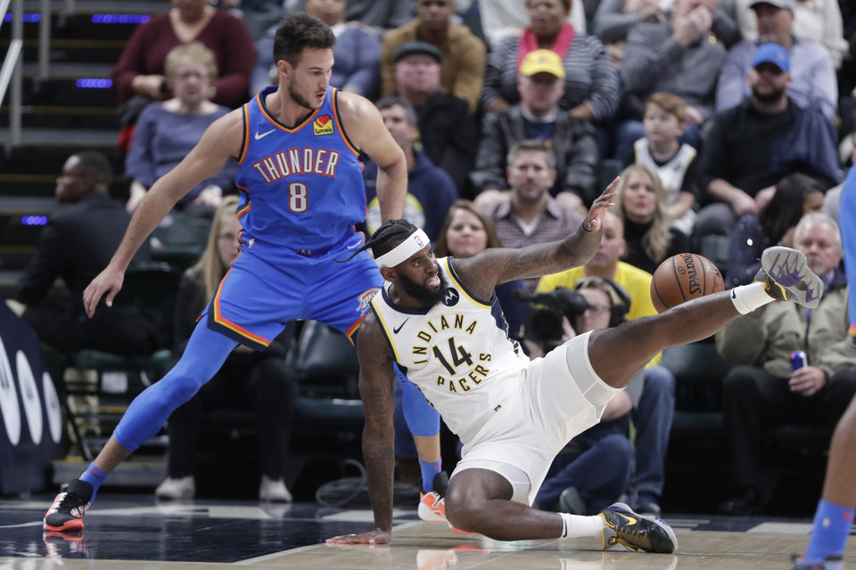 Photo - Indiana Pacers forward JaKarr Sampson (14) loses the ball in front of Oklahoma City Thunder forward Danilo Gallinari (8) during the first half of an NBA basketball game in Indianapolis, Tuesday, Nov. 12, 2019. (AP Photo/Michael Conroy)