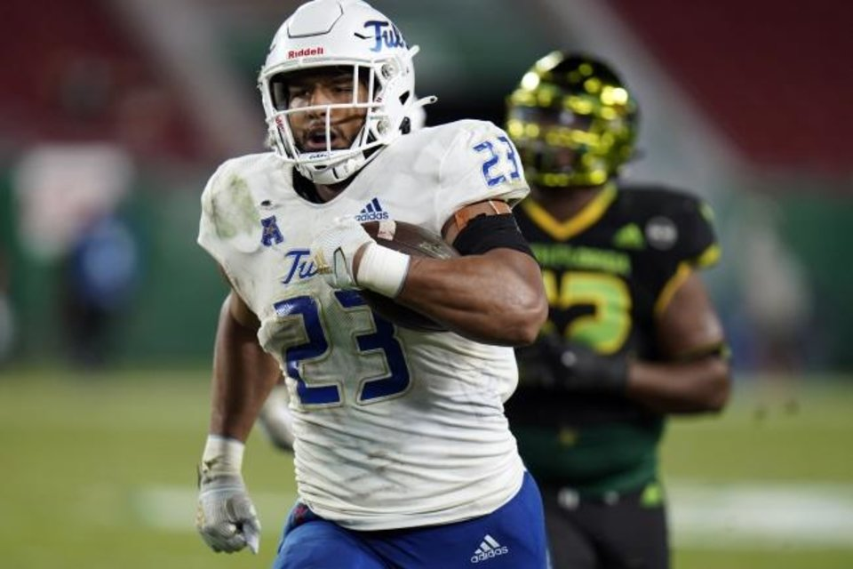 Photo -  Tulsa linebacker Zaven Collins (23) runs back an interception for a touchdown against South Florida during the second half of a 42-13 win on Oct. 23 in Tampa, Fla. [AP Photo/Chris O'Meara]