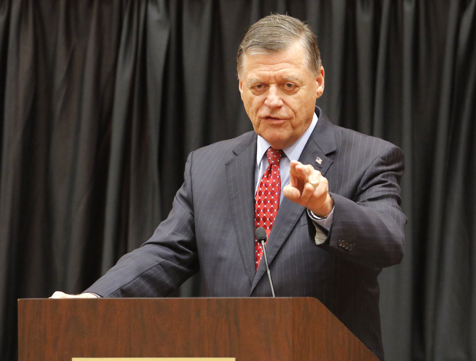 Photo - U.S. Representative Tom Cole talks to members of the National Association of Royalty Owners during their annual conference in Norman, Friday April 21, 2017. Photo By Steve Gooch, The Oklahoman