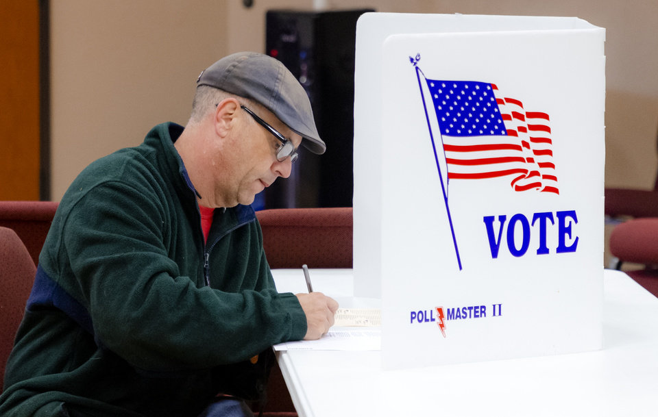 Photo - A voters fills out his ballot at the International Pentecostal Assembly in Yukon, Okla. on Tuesday, Nov. 3, 2020. [Chris Landsberger/The Oklahoman]