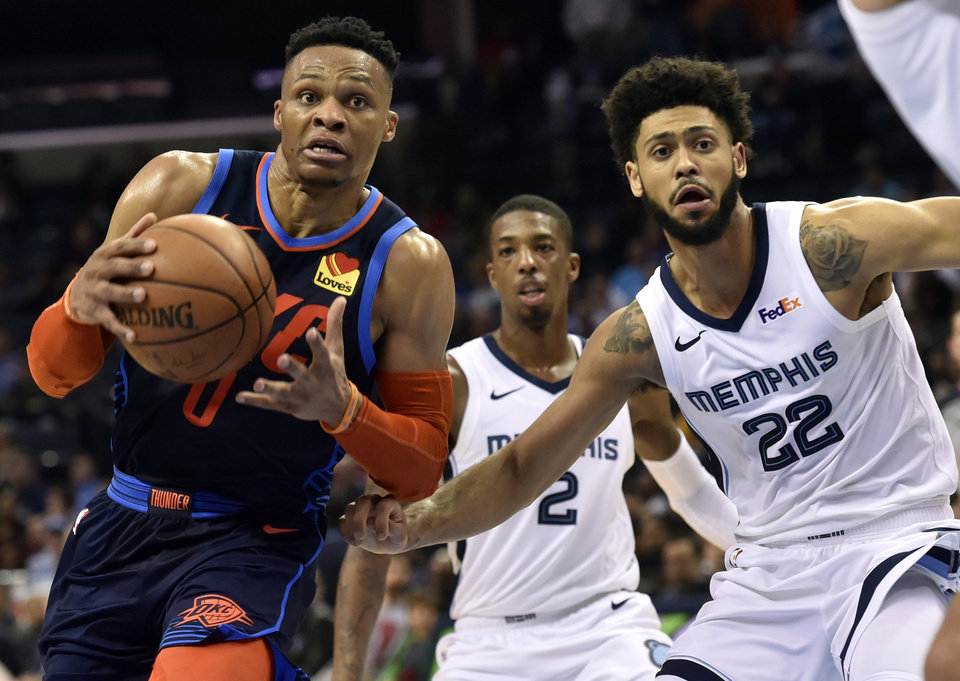Photo - Oklahoma City Thunder guard Russell Westbrook (0) drives ahead of Memphis Grizzlies guards Tyler Dorsey (22) and Delon Wright (2) during the second half of an NBA basketball game Monday, March 25, 2019, in Memphis, Tenn. (AP Photo/Brandon Dill)