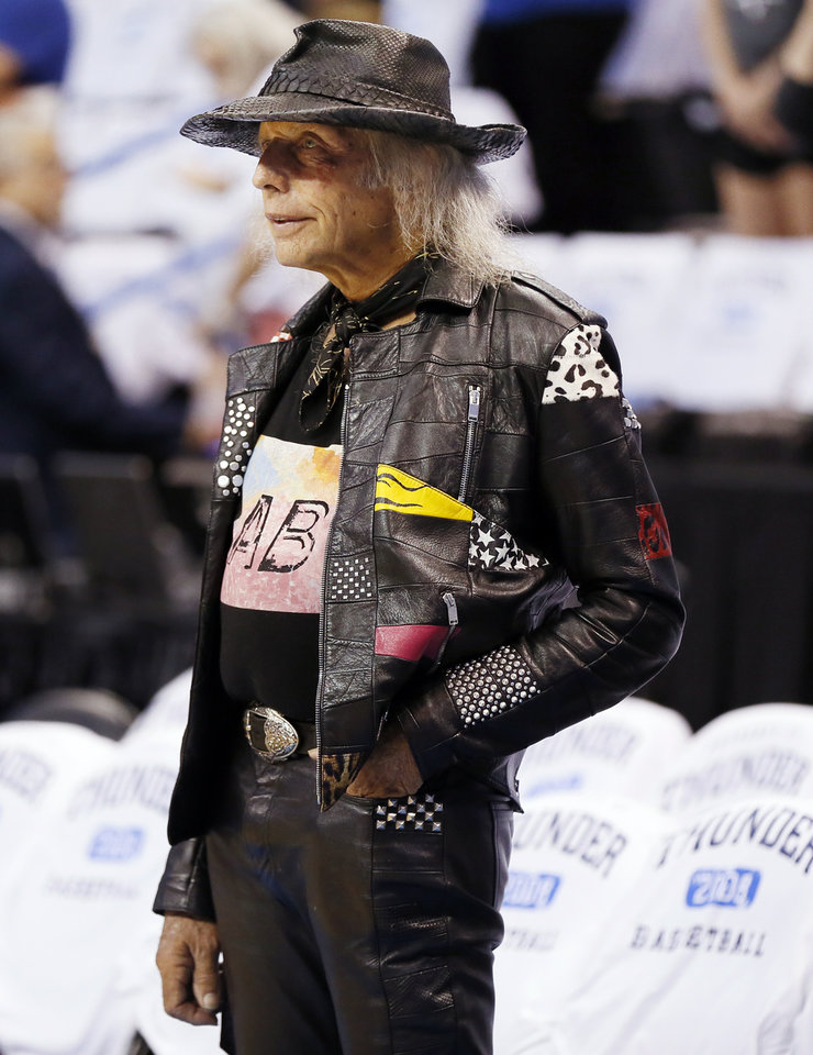 Photo - James Goldstein watches the teams warm up before Game 4 of the Western Conference semifinals between the Oklahoma City Thunder and the San Antonio Spurs in the NBA playoffs at Chesapeake Energy Arena in Oklahoma City, Sunday, May 8, 2016. Photo by Nate Billings, The Oklahoman