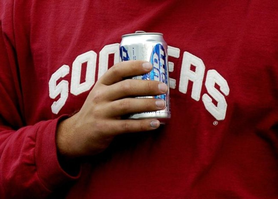 Photo -  Following a growing trend in college sports, beer will be sold throughout the stadium at OU football games this season for the first time. [The Oklahoman archives]