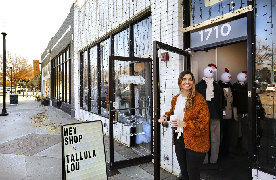 Photo -  Melea Stockton stands in the doorway of one of the two adjacent shops she owns in the 1700 block of NW 16 in the Plaza District. Stockton is the owner of Jackson Dean + Co., and the business next door, Tallulah Lou. She and her staff in both stores stayed busy Friday putting out decorations and preparing inventory and in-store displays for Saturday's customers. [Photo by Jim Beckel, The Oklahoman]