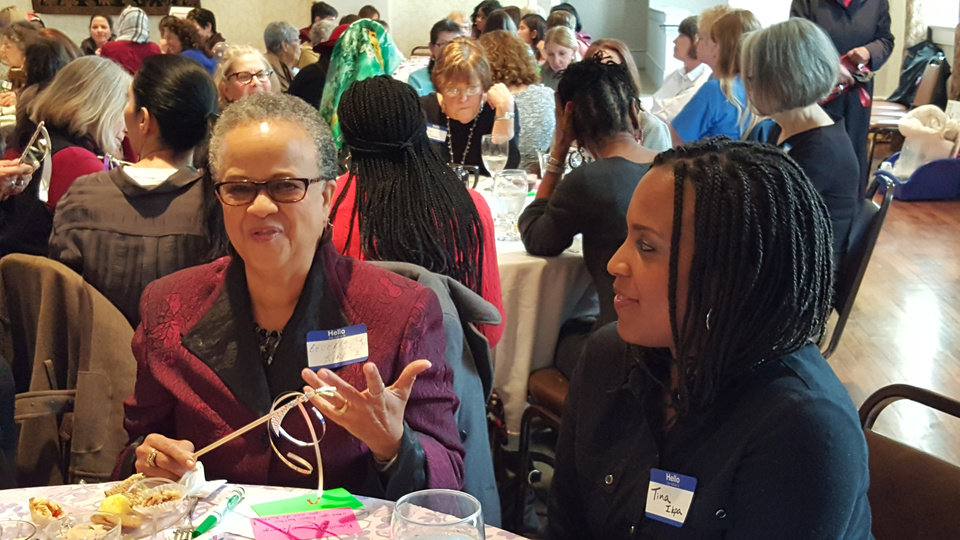 Photo -  Beverly Kirk and Tina Ikpa talk during a discussion at their table at the Diversi-Tea. Event organizers planned for a Jew, a Muslim and a Christian to sit at each table during the Jan. 17 event. [Photo by Carla Hinton, The Oklahoman]