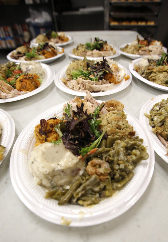 Photo - Thanksgiving dinner at the Westtown day shelter in Oklahoma City, Wednesday November, 23 2016. Photo By Steve Gooch, The Oklahoman