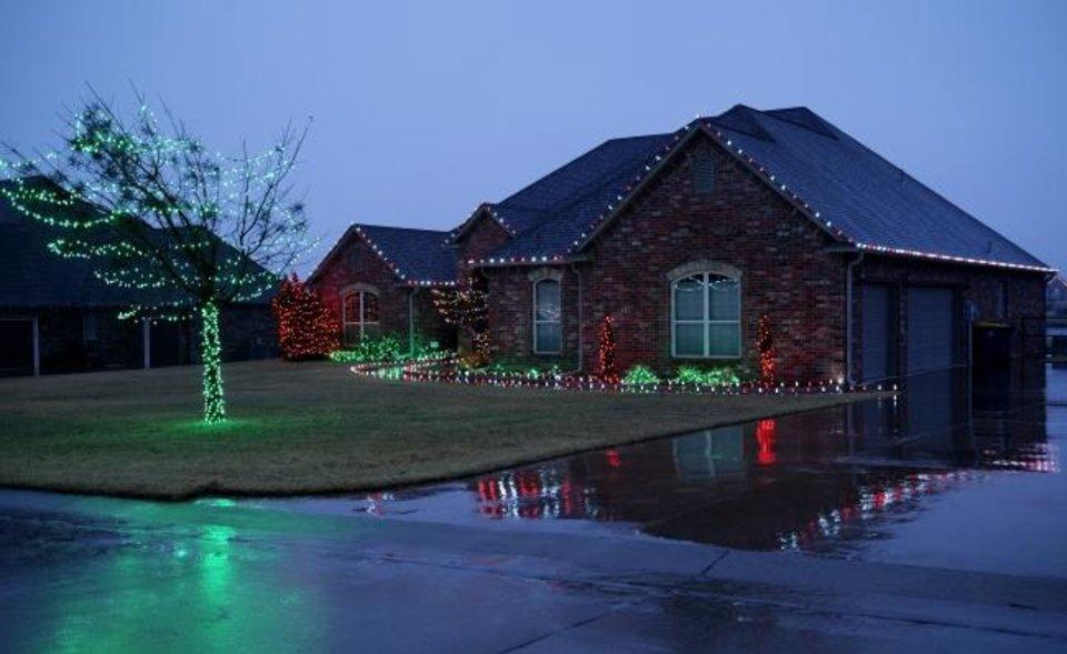 Photo -  Christmas decorations at 832 Sterling Drive in Choctaw. [DOUG HOKE/THE OKLAHOMAN]