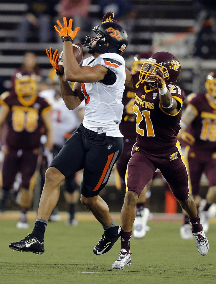Photo - Oklahoma State's Marcell Ateman (3) makes a catch as during the college football game between the Central Michigan Chippewas and the Oklahoma State University Cowboys at the Kelly/Shorts Stadium in Mount Pleasant, Mich., Thursday, Sept. 3, 2015. Photo by Sarah Phipps, The Oklahoman