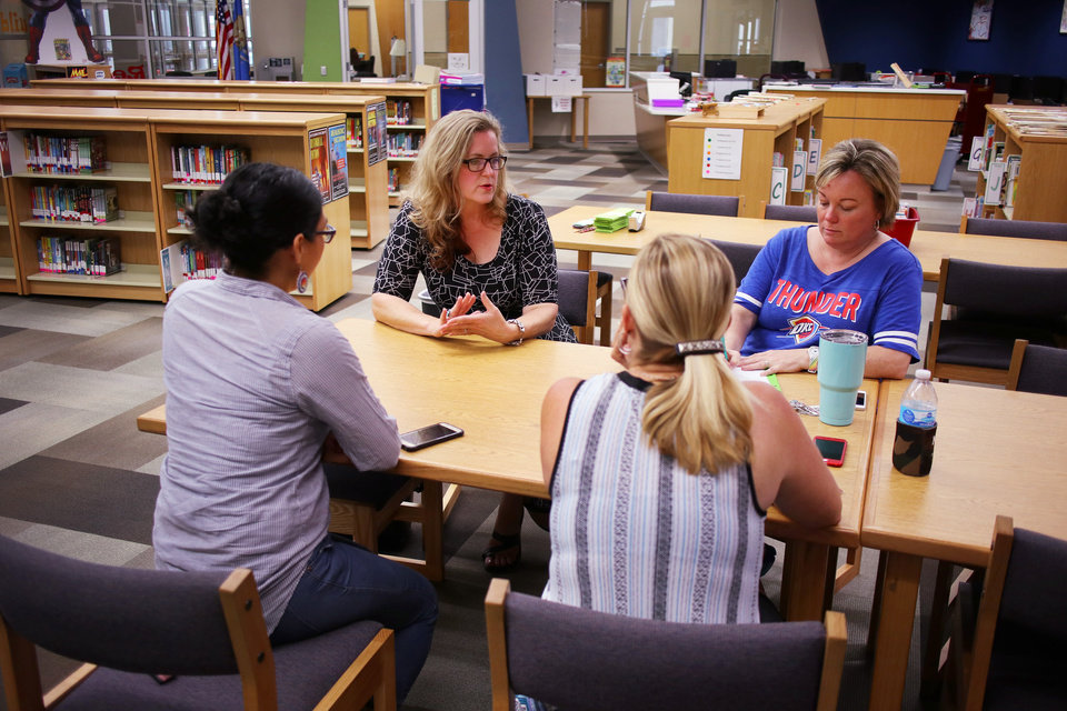 Photo -  Sarah Carnes, a Mustang art teacher, who is running for public office, meets with a teacher advocacy group recently at Prairie View Elementary school. [Photo by Doug Hoke, The Oklahoman]