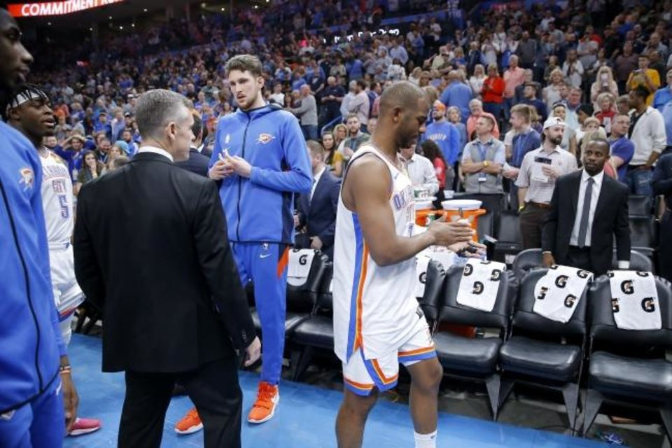 Photo -  Oklahoma City coach Billy Donovan, Mike Muscala, and Chris Paul leave the court with the rest of the team before an NBA basketball game between the Oklahoma City Thunder and the Utah Jazz was postponed at Chesapeake Energy Arena in Oklahoma City, Wednesday, March 11, 2020. [Bryan Terry/The Oklahoman]