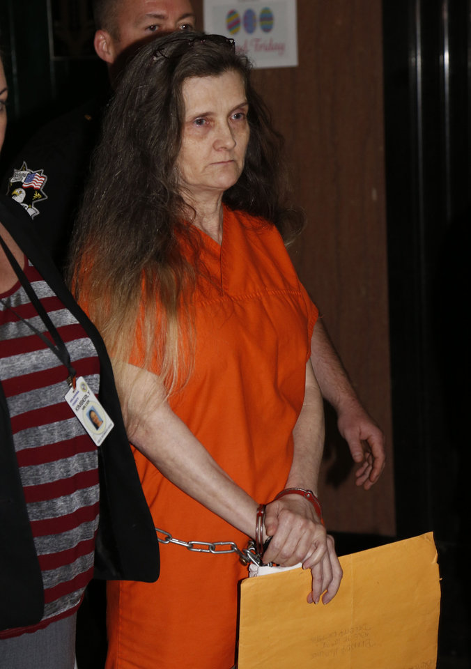 Photo -  Geneva Robinson arrives in court Thursday for her child abuse sentencing. [Photo by Paul Hellstern, The Oklahoman]
