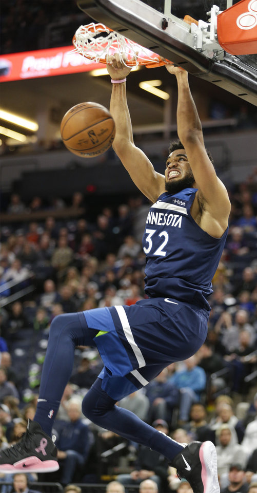 Photo - Minnesota Timberwolves center Karl-Anthony Towns (32) dunks during the first half of a NBA basketball game against the Oklahoma City Thunder Sunday, April 7, 2019, in Minneapolis. Towns finished with a game-high 53 points as Oklahoma won 132-126. (AP Photo/Paul Battaglia)