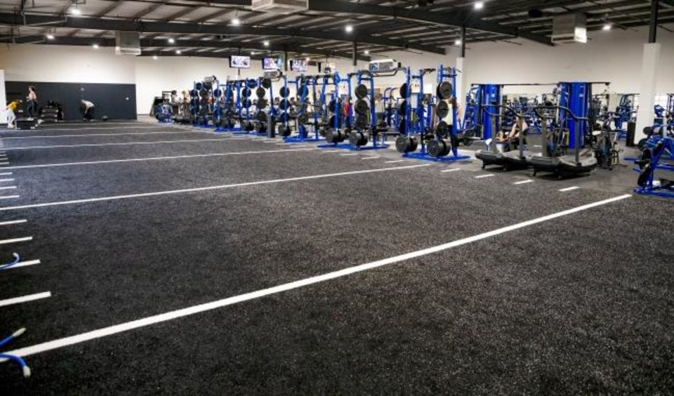 Photo -  Exercise and training space is shown at the newly renovated Oklahoma Athletic Center. [CHRIS LANDSBERGER/THE OKLAHOMAN]