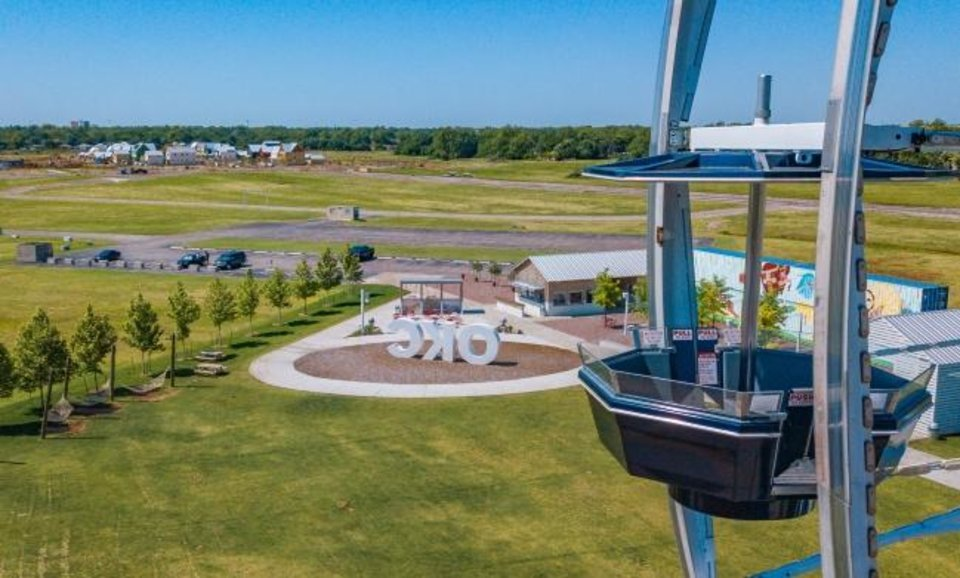 Photo -  The new Wheeler neighborhood can be seen from atop the community's Ferris wheel along the Oklahoma River. [Dave Morris/The Oklahoman]