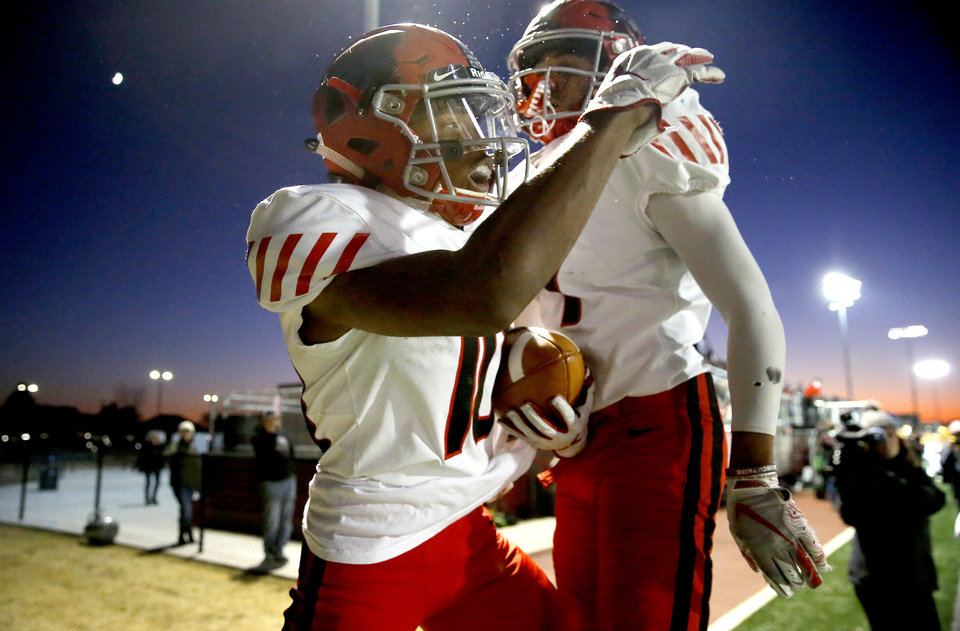 Photo - Mustang's Khary Brown, left, and Harvey Phillips celebrate after Brown scored a touchdown during a high school football game between Putnam City North and Mustang in Oklahoma City, Friday, Nov. 1, 2019.  [Bryan Terry/The Oklahoman]