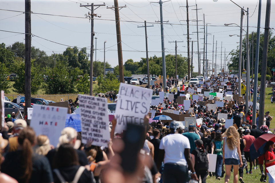 Photo - Protestors march during a Black Lives Matter rally in Oklahoma City,  Sunday, May 31, 2020.  [Bryan Terry/The Oklahoman]