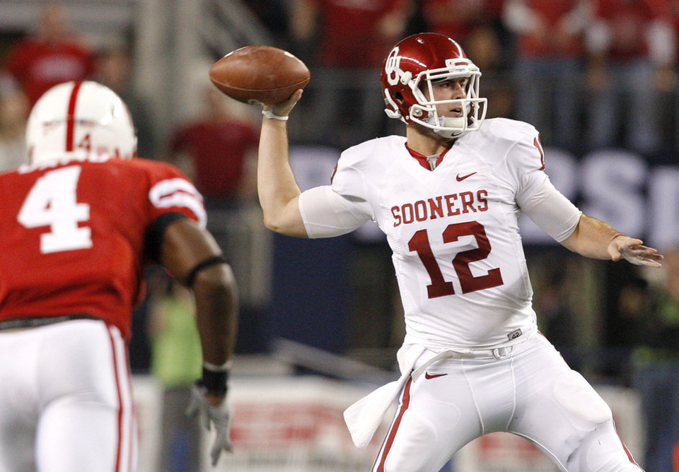 Photo - OU's Landry Jones throws a pass during the Big 12 football championship game between the University of Oklahoma Sooners (OU) and the University of Nebraska Cornhuskers (NU) at Cowboys Stadium on Saturday, Dec. 4, 2010, in Arlington, Texas.  Photo by Bryan Terry, The Oklahoman